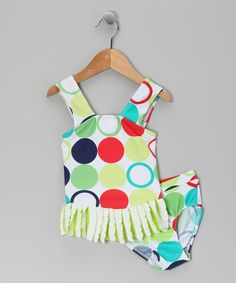 Perfect for dipping teeny toes in the water, this tankini is pepped up with a vibrant print and a frilly ruffle hem. Stretchy fabric and a lined design make it comfy for beach babes to wear.Includes top and bottoms92% polyester / 8% spandexMachine wash; hang dryMade in the Dominican R...