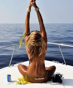 .. bikini. boat. camera. drink ..
