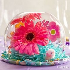 Instead of snow globe, think spring globe!  Use fresh flowers and fuzzy chicks to make a stunning springtime centerpiece - perfect for an Easter party!