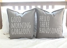 pillow cases in gray with white lettering