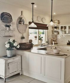 A farmhouse style ktichen. Come see this salvaged farmhouse home tour with lots of farmhouse inspiration.