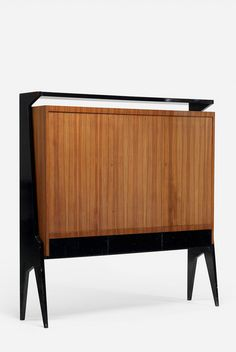 René Prou; Walnut, Lacquered Wood and Brass Cabinet, c1940.