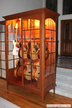 Guitar display case or cabinet that is Humidity controlled - This guitar cabinet system is the first and only way to safely display your guitars in a climate controlled environment especially for stringed musical instruments. Guitar Display Case, Guitar Storage, Guitar Rack, Guitar Hooks, Home Music Rooms, Music Studio Room, Man Cave Furniture, Cool Furniture, Guitar Cabinet