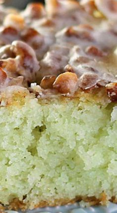 Pistachio Poke Cake ~ Starts with a cake mix so it's super easy and always a crowd pleaser. Topped with pecans and filled with delicious pistachio pudding, this cake is simple yet irresistible - You will be asked for the recipe! Potluck Desserts, Easy Desserts, Delicious Desserts, Dessert Recipes, Dessert Sauces, Dessert Ideas, Cake Ideas, Pistachio Dessert, Pistachio Recipes