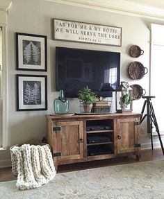 The tv mounted in corned with some kind of table/dresser below remove drawers add pretty wicked baskets/boxes for added storage
