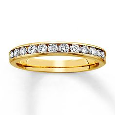 Something like this ....mother's day, anniversary, Maybe a size 8?  Anniversary Band 1/2 ct tw Round-Cut 14K Yellow Gold