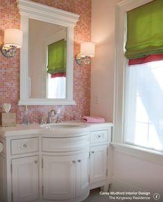 Pink tile behind mirror