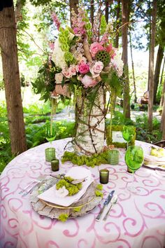 Gorgeous centerpiece. I'd change the pink to dark plum and ivory and add ferns. I love love love, especially the moss. Sigh