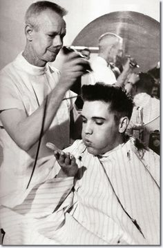 Elvis gets his army haircut