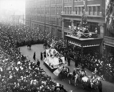 The Eatons Santa Claus Parade on James Street, 1918, Toronto, Ontario, Canada. At the end of the parade, Santa would climb from his float up a ladder into the Eatons department store. Source: Archives of Ontario