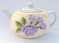 Cream knitted 2 cup teapot cozy decorated with crochet appliques