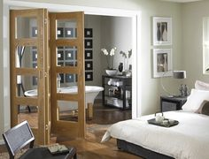 Oak 4 light clear glass Folding Internal Door - contemporary - interior doors - - by Savoy Contemporary Interior Doors, Door Design Interior, Interior Barn Doors, Modern Interior, Design Interiors, Exterior Doors, Bifold French Doors, Glass Room Divider, Room Dividers