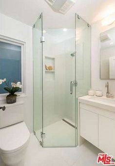 Bathroom Decor Ideas : Description Glass shower walls prevent this petite bathroom from feeling too crowded. The mirror, window, and white palette also opens up the space. Glass Bathroom, Bathroom Renos, Bathroom Renovations, Bathroom Interior, Downstairs Bathroom, Bad Inspiration, Bathroom Inspiration, Small Bathroom Layout, Corner Shower Small