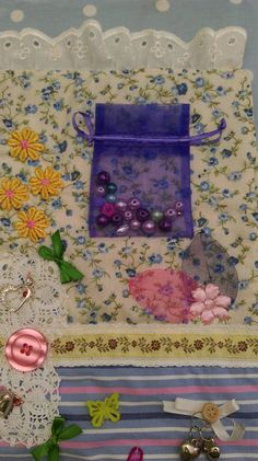 Another close up of Audreys quilt Beads sewn into a bag and the bag firmly sewn across the top to allow Audrey to lift the bag and feel the beads. Christchurch Fidget Ladies