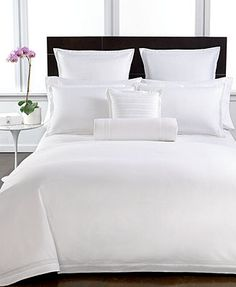 Love the all white bedding and dark headboard...perfect for our new king bed