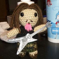 """Working up a Dimebag Darrell Pantera doll for a Christmas present :D no pattern used. ;) Winged it on this one. Going to make him a better guitar from felt, just printed this one for a """"template"""" Will have him available for purchase soon."""