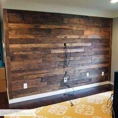 $20 DIY Pallet Wall   Sweet, sweet candy. More pallet wall details at http://www.ifinishedmybasement.com/basement-ideas/wood-pallet-wall/