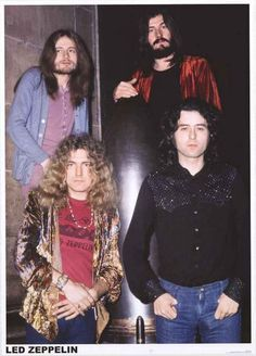A great Led Zeppelin band portrait poster of Robert Plant, Jimmy Page, John Paul Jones, and John Bonham with a bombshell! Ships fast. 24x33 inches. Ramble On over and check out the rest of our amazing