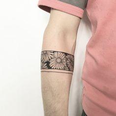 tattoo man , tattoo arm , tattoo flower band