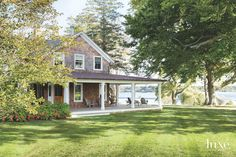 shingle-style home with wraparound porch | Carrier and Company Interiors