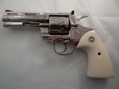"""You're not bulletproof..., Colt Python A custom engraved example with the 4""""..."""