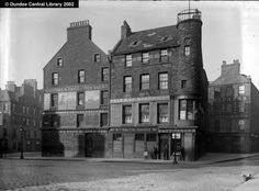 High Street, Dundee - Ref: WC0245. This photograph was taken from a site in front of Strathtay House (the present-day Boots) and shows the west end of Dundee High Street, the building at the extreme left being the south side at the junction with Crichton Street. The road to the righthand side (and north) is the Overgate. The photograph was taken before June 1896, when the new Dundee Directory lists No. 47 (here William Smith, hatter) as Nathan & Co., jewellers.