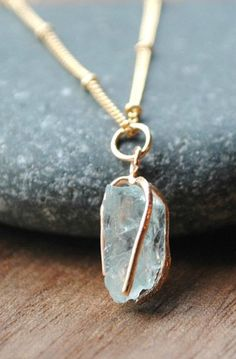 Raw aquamarine pendant necklace is March's birthstone. Necklace features a raw aquamarine pendant and hangs from a beaded Satellite chain in gold or silver. Aquamarine Pendant, Aquamarine Necklace, Diamond Pendant, Crystal Necklace, Pendant Necklace, Aquamarine Stone, Gold Necklace, March Birthstone Necklace, Birthstone Jewelry