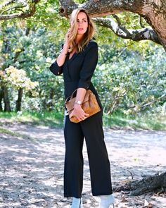 Jumpsuit worn with booties and purse | Photo shared by Claudia Kooij | For more style inspiration visit 40plusstyle.com
