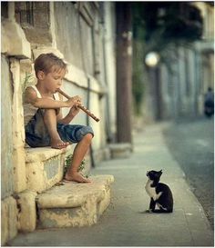 boy, his music, and a kitty cat