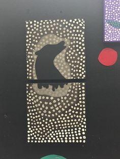 Medium: Paint This is a painting of my dream representing darkness. I used different shades of brown to create dots around a black wolf.