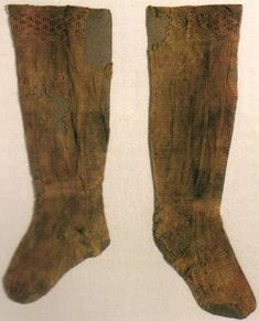 """Eleanora of Toledo's Silk Stockings  Lady Caelfind """"Spider"""" ingen Failtigerna  Eleanora of Toledo was a duchess from the 16th century, Italy. Her burial clothes included these stockings which are one of the first examples where knit and purl stitches were used as decorative elements in the design."""