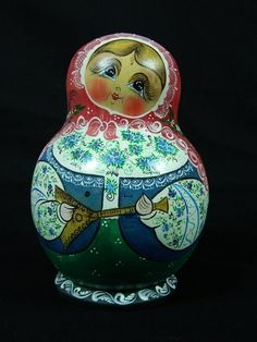 Russian Hand Painted Matryoshka dolls. It is a 15 piece set in Great Condition. Music Themed in the artwork and signed by the Russian Artist...