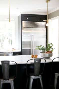 A kitchen/dining nook makeover - desire to inspire - desiretoinspire.net - H2 Design + Build - black and white and brass - tolix stools