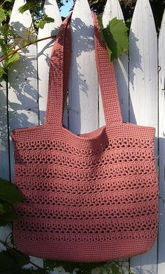 Tote bag made with worsted 100% cotton yarn, Lily Sugar 'n Cream confectionary yarn. Hook sizes E & F. Takes a little more than 12 oz for pattern.