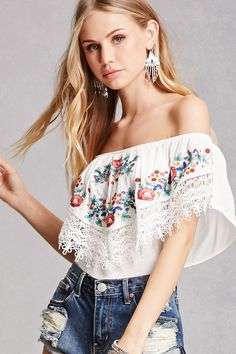 A knit cheeky bodysuit featuring an elasticized off-the-shoulder neckline, a woven flounce layer with front floral embroidery and crochet trim, and a snap-button closure.<p>- This is an independent brand and not a Forever 21 branded item.</p>
