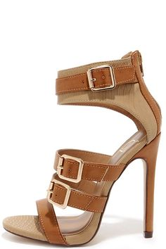 """You won't have to explain why the Show and Tall Tan Snakeskin Belted High Heel Sandals are so great; their leg-lengthening factor is apparent to all! Light tan snakeskin-embossed vegan leather is belted with a tan toe band, plus three more adjustable tan straps with gold buckles. 3"""" heel zipper introduces a 4.75"""" wrapped stiletto heel on a single sole. Cushioned insole. Rubber sole has nonskid markings. Available in whole and half sizes. Measurements are for a size 6. All vegan friendly, man…"""