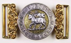 A Queen's Regiment The Royal West Surreys officer's post-1881 waist belt clasp, in gilt and white metal, acanthus scrolls to the ends, circlet with ' Pristinae Virtutis Memor' in capitals, centre with paschal lamb to a gilt and dimpled ground, both parts stamped '4'.
