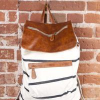 Cream and black leather flap backpack