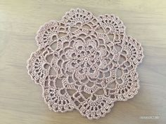 I made this mini doily using 100% cotton lace yarn with 2.00mm crochet hook.It's about14.5cm in diameter, so it can be u