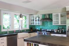 Kitchen- bright back splash and counter tops.