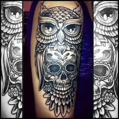 Owl skull tattoo.