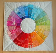 Sonnenschein quilt.  Can't tell how big this is from the pic, but wouldn't it make just a lovely baby quilt?  Great way to use up scraps, too.