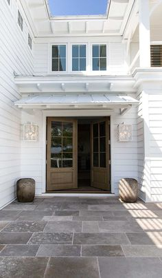 White Exterior - Metal Roof - Wood Doors