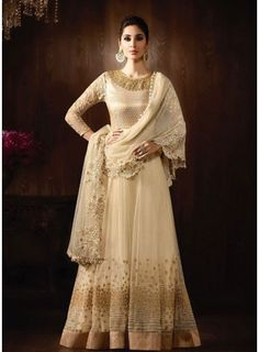 Fuse aesthetic styles with elaborate designs with this pristine cream brocade and net floor length designer suit. This attire is graced with awesome embroidered and cut....