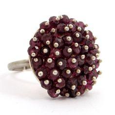 Garnet Stones in Stering Silver Ring. Handmade rhodium plated sterling silver ring with garnet stones. Adjustable size.