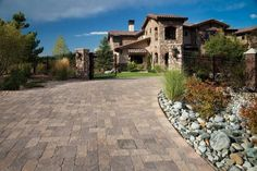 Colorful, durable concrete pavers provide an easy and elegant way to improve your family's quality of life now and your home's curb appeal when the time comes to sell. Outdoor Spaces, Outdoor Living, Interlocking Pavers, Sand And Gravel, Building Stone, Concrete Pavers, Driveways, Walkways, Best Sites