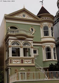 "An extremely attractive house in San Francisco (I think). The body color is lovely and the brown, ivory, and gold accents beautifully highlight the gorgeous architectural details. The square ""bay"" window with balcony on top is especially wonderful."
