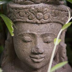 A serene carving in the gardens of Villa Bunga Wangi - Canggu, Bali