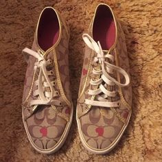 Coach tennis shoes Worn a few times, still in great condition. Only selling because I've gone down a shoe size and they are way too big. Coach Shoes Sneakers