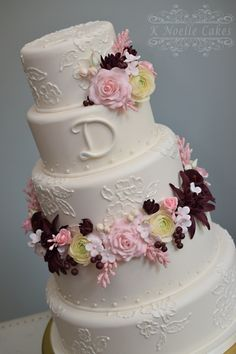 Wedding cake with sugar flowers and Embossed flowers by K Noelle Cakes